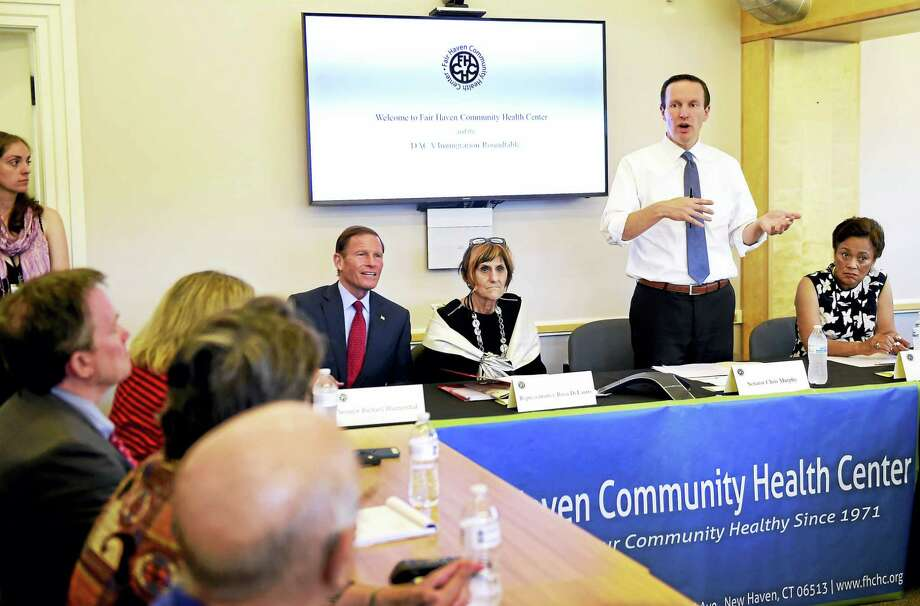 U.S. Sen.Chris Murphy, D-Conn.,  third from left, starts a roundtable discussion Friday at the Fair Haven Community Health Care Center in New Haven. Seated are, from left, U.S. Sen. Richard Blumenthal, D-Conn., U.S. Rep. Rosa DeLauro, D-3, and New Haven Mayor Toni Harp. Photo: Peter Hvizdak / Hearst Connecticut Media   / Peter Hvizdak