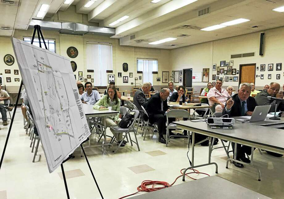 Attorney Peter J. Alter points to an overhead map of Farm River Rock quarry during an East Haven Zoning Board of Appeals Commission Thursday at the East Haven Senior Center. Alter is representing the quarry, which is appealing two cease and desist letters from the town. Photo: Esteban L. Hernandez / Hearst Connecticut Media