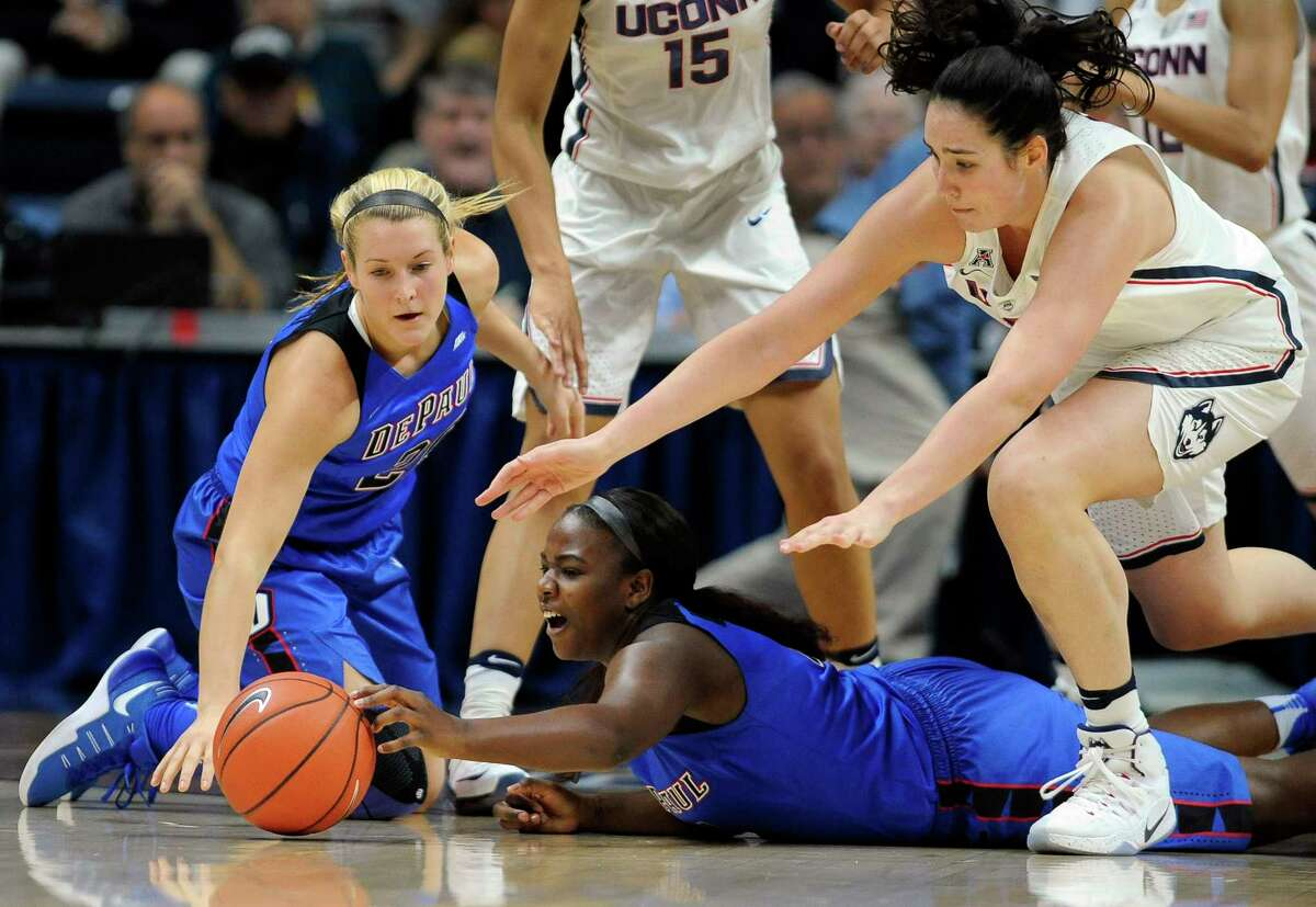 DePaul's Kelly Campbell, left, Ashton Millender, center, and Connecticut's Natalie Butler, right, reach of a loose ball in the first half of an NCAA college basketball game, Thursday, Dec. 1, 2016, in Storrs, Conn.