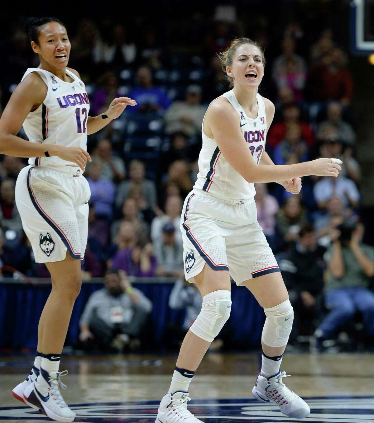 Connecticut's Saniya Chong, left, and Katie Lou Samuelson react in the first half of an NCAA college basketball game against DePaul, Thursday, Dec. 1, 2016, in Storrs, Conn.