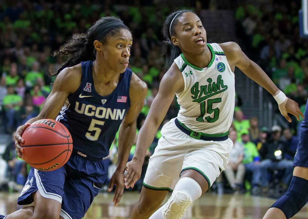 Connecticut's Crystal Dangerfield (5) drives by Notre Dame's Lindsay Allen (15) during the second half of an NCAA college basketball game Wednesday, Dec. 7, 2016, in South Bend, Ind. Connecticut won 72-61.