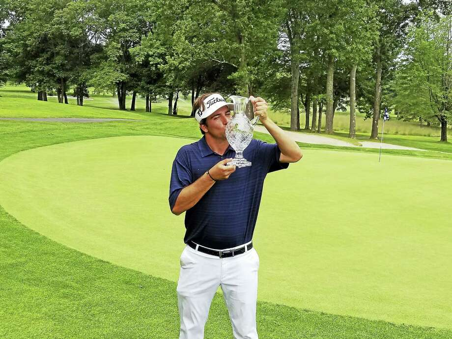 Jeffrey Evanier from Clinton Country Club kisses the championship crystal after winning the 83rd Connecticut Open. Photo: Joe Morelli - Connecticut Hearst Media