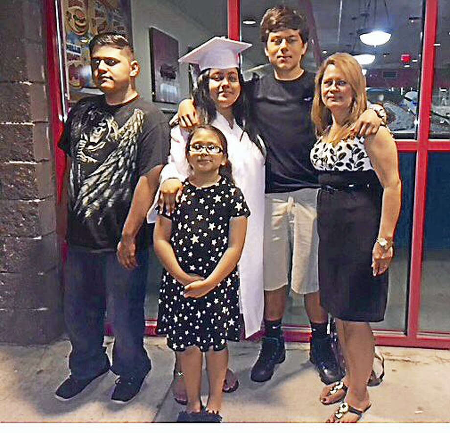 CONTRIBUTED PHOTO  Nury Chavarria, right, with her children. Photo: Digital First Media
