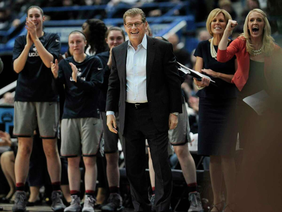 Connecticut head coach Geno Auriemma, center, and his team reacts in the first half of an NCAA college basketball game against South Florida, Tuesday, Jan. 10, 2017, in Hartford, Conn.