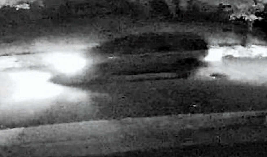 Police are searching for two vehicles that may have been involved in an intentionally set car fire. Photo: Photo Courtesy Of Milford Police