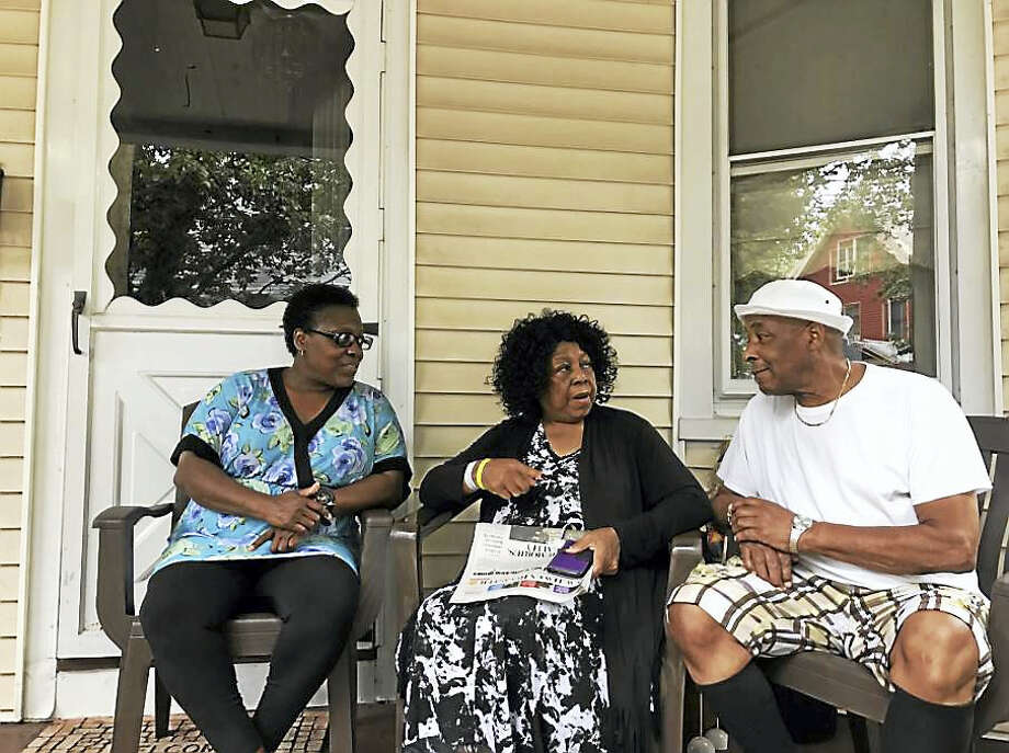 Newhallville residents Ingrid Thomas, Albertha Nelson and Marshall Curry discuss safety after a weekend shooting that critically injured a 14-year-old. Photo: JESSICA LERNER / HEARST CONNECTICUT MEDIA