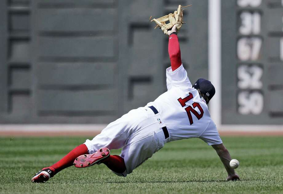 Red Sox second baseman Brock Holt dives but can't make the play on a single by the Blue Jays's Steve Pearce on Thursday. Photo: Charles Krupa — The Associated Press   / Copyright 2017 The Associated Press. All rights reserved.