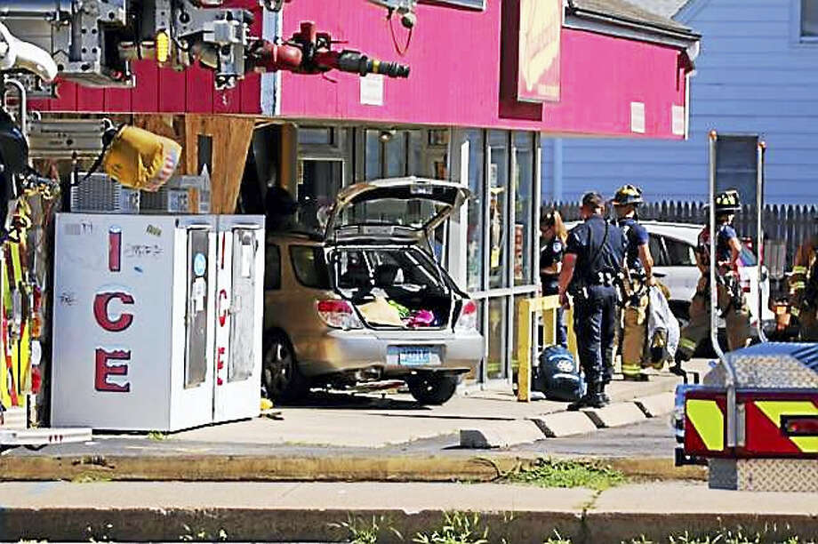 A car has crashed into a Krauszers convenience store in Milford. Photo: Courtesy Of Edgar Breban