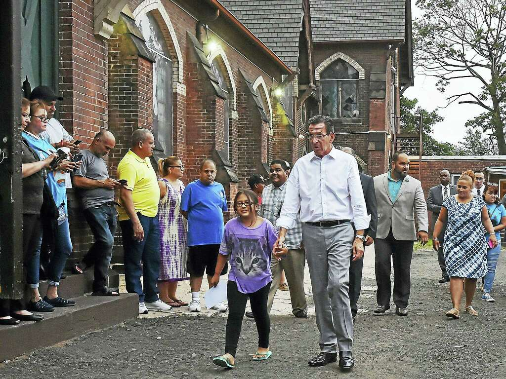 Gov. Dannel P. Malloy Walks With Hayley Chavarria, 9, Before Speaking At