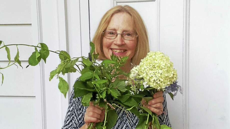 """Martha """"Muffy"""" German brought plants from the Country Club of Woodbridge when she spoke before the Board of Selectmen Wednesday to tell them how in invasive species are stifling and covering flowers. Photo: Pam McLoughlin / Hearst Connecticut Media"""