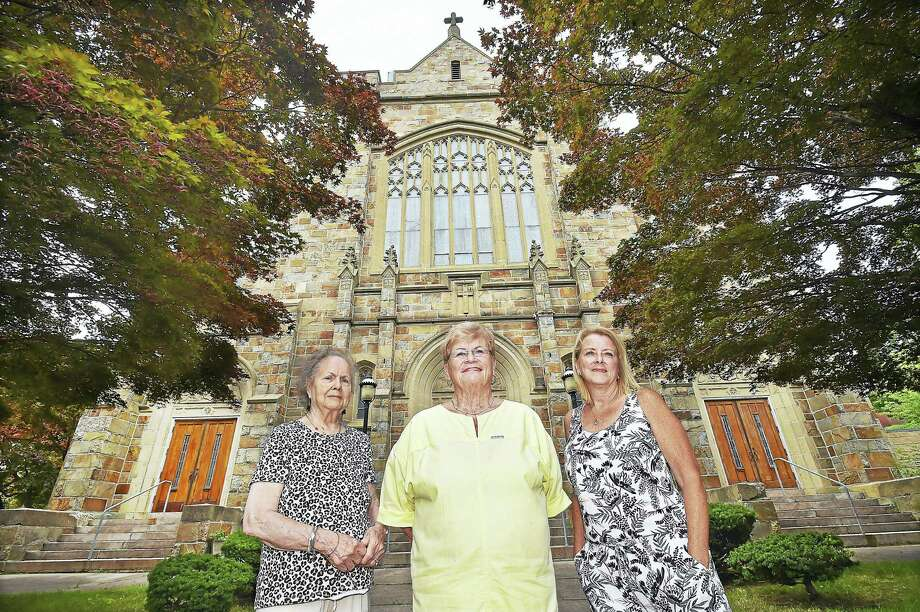 Norma Proto, 88, Dot Gemmell, 83, and Karen DeLaurentis Pallotto, 60, left to right, former parishioners at St. Brendan Church, are photographed July 1 at the church at 455 Whalley Ave. in New Haven. Photo: Catherine Avalone / Hearst Connecticut Media   / Catherine Avalone/New Haven Register