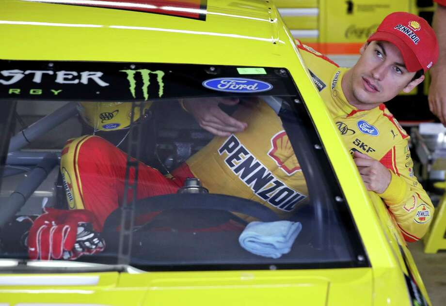 Joey Logano climbs into his car as he prepares for a practice session for Sunday's race at New Hampshire Motor Speedway in Loudon, N.H. Photo: Charles Krupa — The Associated Press   / Copyright 2017 The Associated Press. All rights reserved.