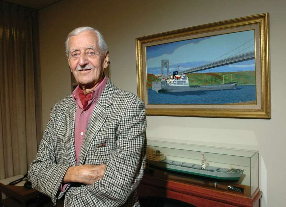 Shipping magnate Ole Skaarup, posed in his Greenwich office in 2006 with a painting of one of his transport ships in the background. Skaarup, chairman of Greenwich-based The Skaarup Group, an international bulk shipping business, has died. Photo: File Photo / Greenwich Time File Photo