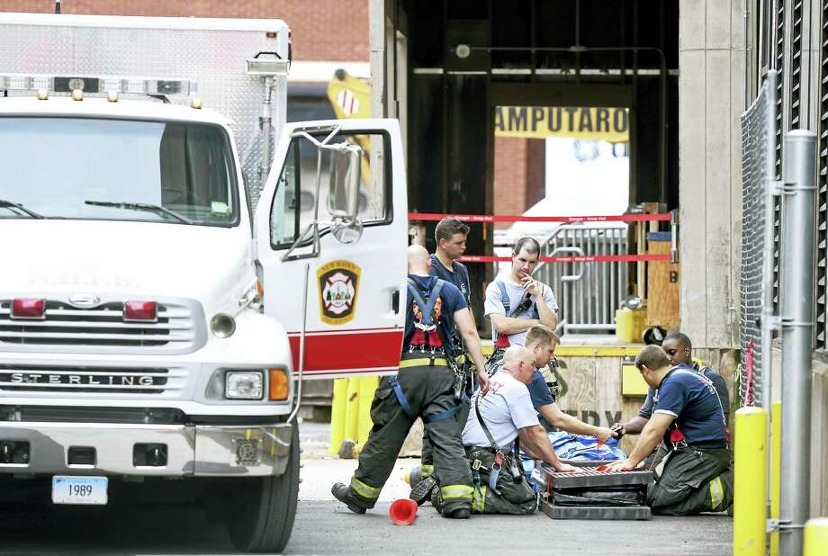 New Haven Fire Department personnel pack up gear after responding to a possible spill of a radio-isotope in the Engineering Department of Yale New Haven Hospital, St. Raphael Campus, in New Haven on Saturday. Photo: Arnold Gold / Hearst Connecticut Media