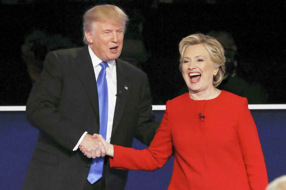 David Goldman / associated press   Then-Republican presidential nominee Donald Trump and then-Democratic presidential nominee Hillary Clinton shake hands after the presidential debate at Hofstra University in Hempstead, N.Y. Photo: AP / Copyright 2016 The Associated Press. All rights reserved.