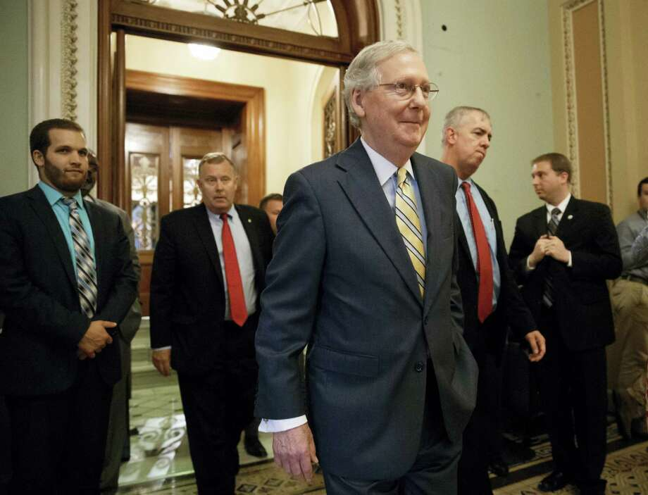 Senate Majority Leader Mitch McConnell of Ky. leaves the Senate chamber on Capitol Hill in Washington, Thursday, July 13, 2017, after announcing the revised version of the Republican health care bill. Photo: AP Photo/J. Scott Applewhite    / Copyright 2017 The Associated Press. All rights reserved.