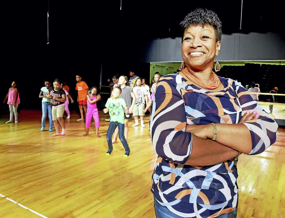 Executive Director Marcella Monk Flake of The Monk Center For Enrichment and Performing Arts during its Talented and Creative Youth Camp at Davis Street School in New Haven practicing a song and dance routine. Photo: Peter Hvizdak / Hearst Connecticut Media   / Peter Hvizdak