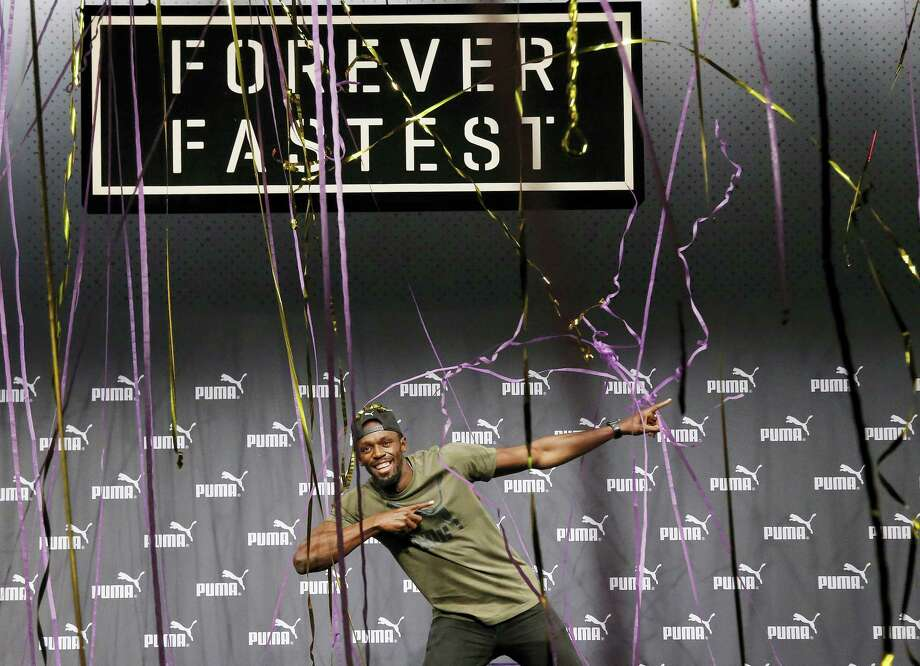 Usain Bolt celebrates after a press conference ahead of the World Athletics championships in London on Tuesday. Photo: Frank Augstein — The Associated Press   / Copyright 2017 The Associated Press. All rights reserved.