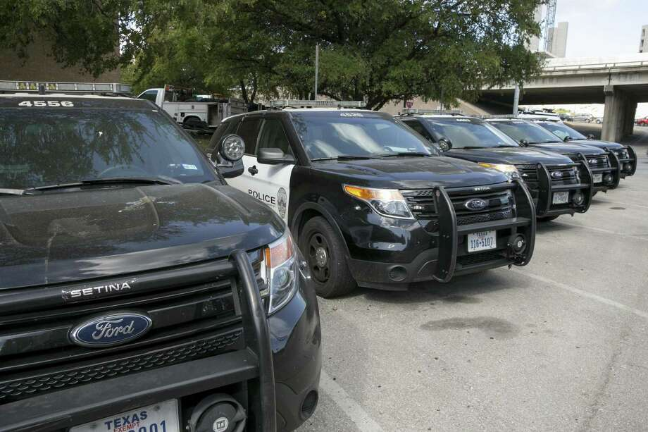 Austin police Ford utility vehicles are parked on East Eighth Street outside police headquarters. Austin police recently arrested a man who is accused of hitting a child while stealing a pickup. Photo: Jay Janner /Austin American-Statesman / Internal