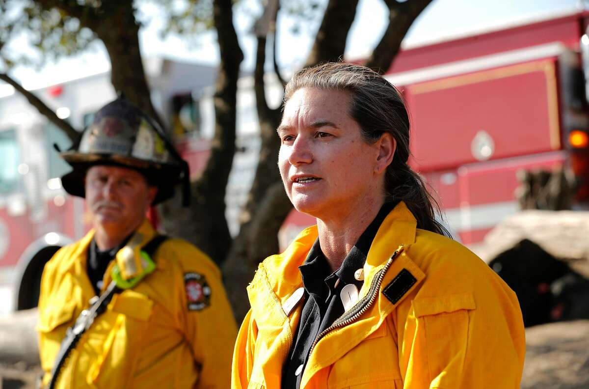 Oakland Battalion Chief Melinda Drayton holds a press conference,as firefighters get the upper hand on a fast moving fire along Grizzly Peak Blvd. on Wed. August 2, 2017, in Berkeley, Ca. Moraga Orinda Fire Chief Stephen Healy is at left.