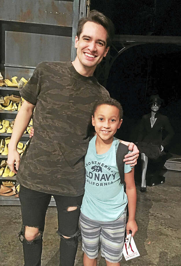 Christian Mullins, right, with Brendon Urie, front man for Panic! At The Disco Photo: CONTRIBUTED PHOTO