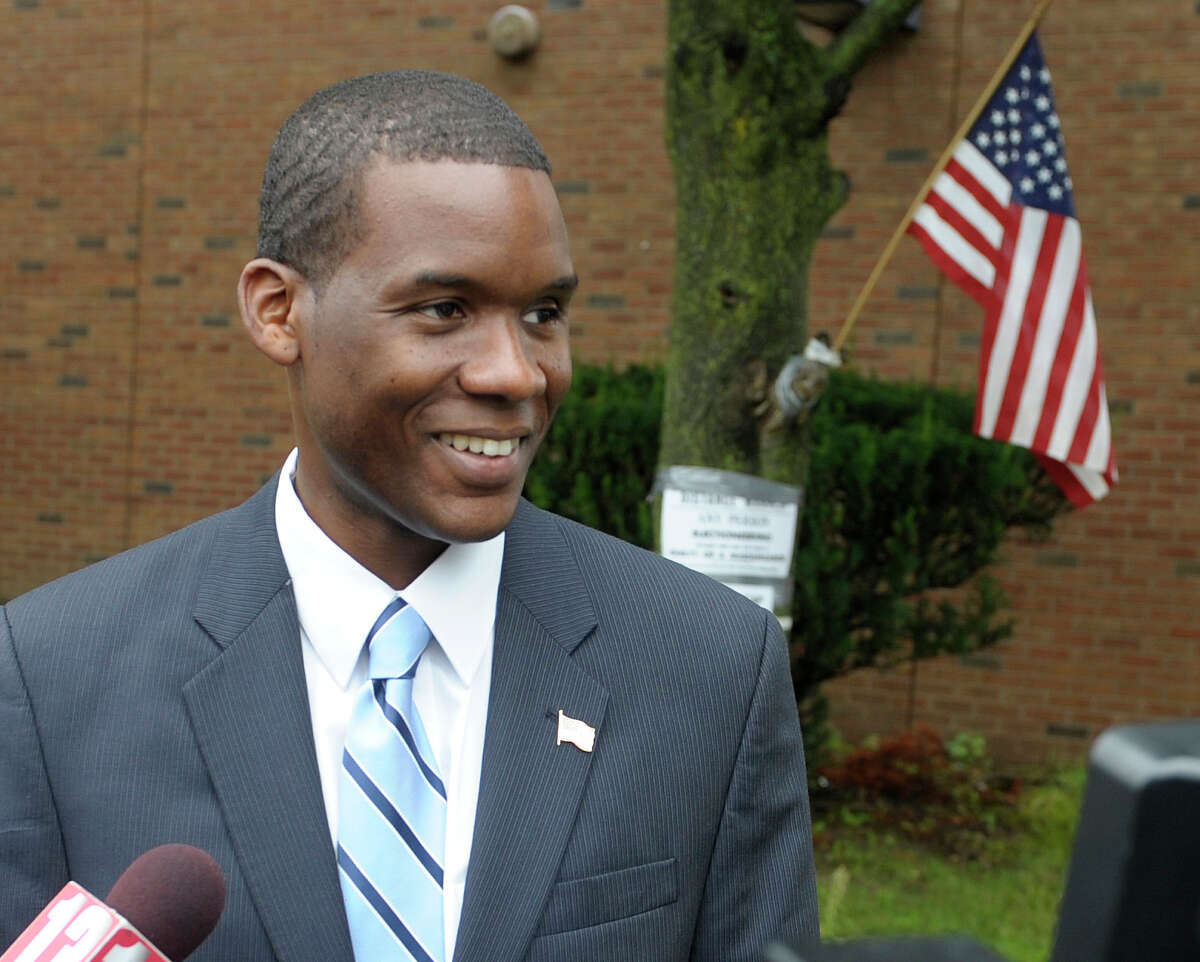 Candidate for Albany mayor, Corey Ellis talks to members of the media after casting his vote at Albany High School on Tuesday, Sept. 10, 2013 in Albany, NY. (Paul Buckowski / Times Union) ORG XMIT: MER2013091111153189