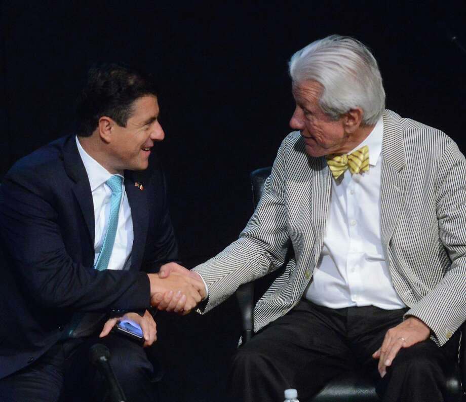 Ambassador Gerónimo Gutíerrez of Mexico (left) shakes hands with media consultant Lionel Sosa after participating in a panel discussion about trade relations at Instituto Cultural de Mexico on Wednesday. Photo: Billy Calzada /San Antonio Express-News / San Antonio Express-News