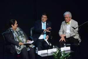 Mexico ambassador to U.S. Geronimo Gutierrez, middle, Consul General Reyna Torres Mendivil, left, and artist and political consultant Lionel Sosa discuss trade relations at Instituto Cultural de Mexico on Wednesday, Aug. 2, 2017.
