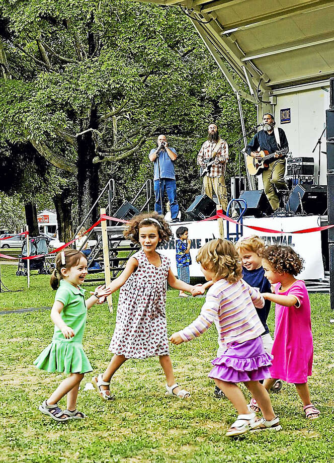 Submitted photo   Children dance to the music on the Guilford Green last year.