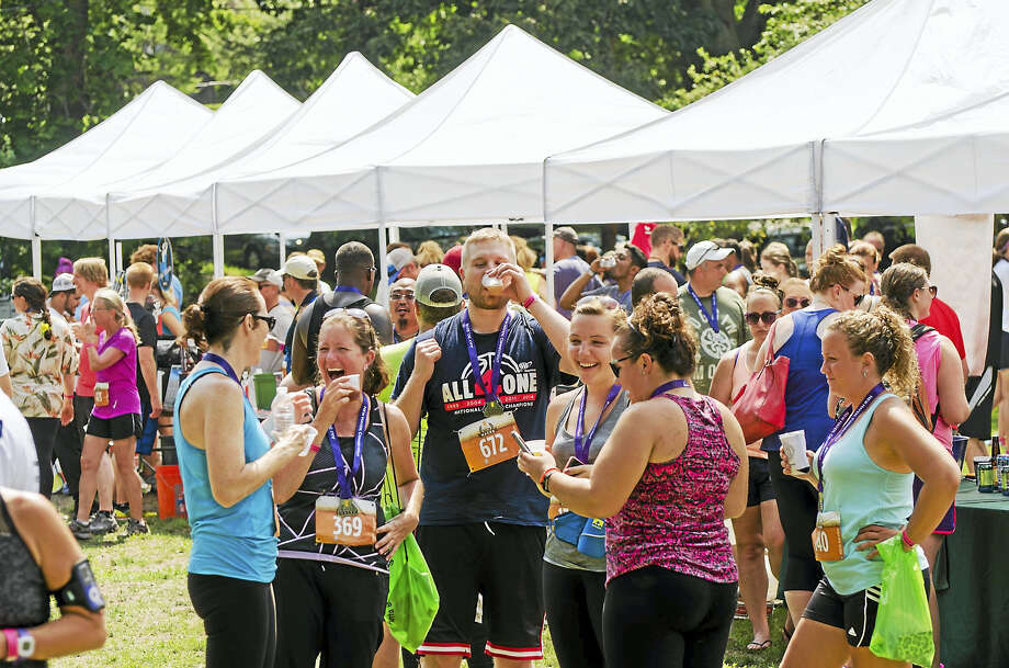 Submitted photo Runners and walkers enjoy a post-race beer at last year's event.