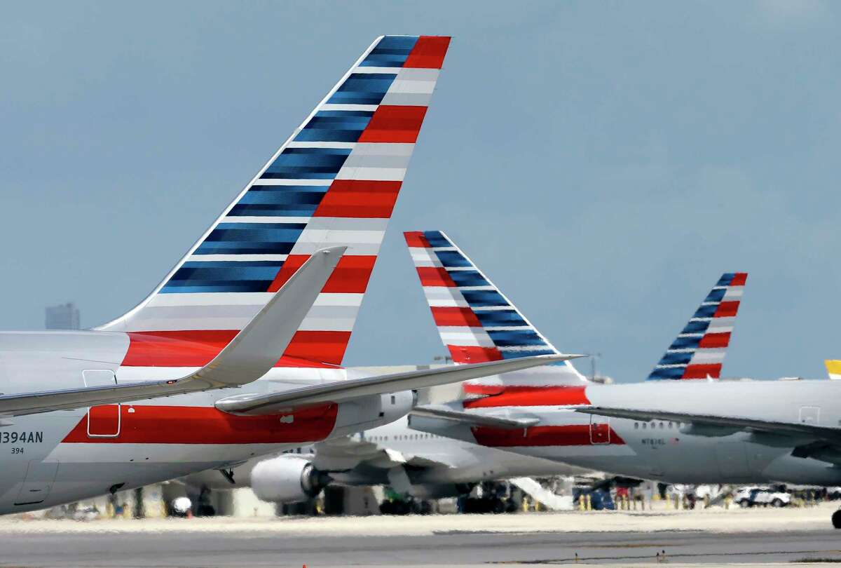 FILE - In this May 27, 2015, file photo, American Airlines jets taxi at Miami International Airport, in Miami. On Wednesday, Aug. 2, 2017, Qatar Airways said it is dropping an attempt to buy a big stake in American Airlines, an audacious bid that had received a chilly reception from American. (AP Photo/Lynne Sladky, File)