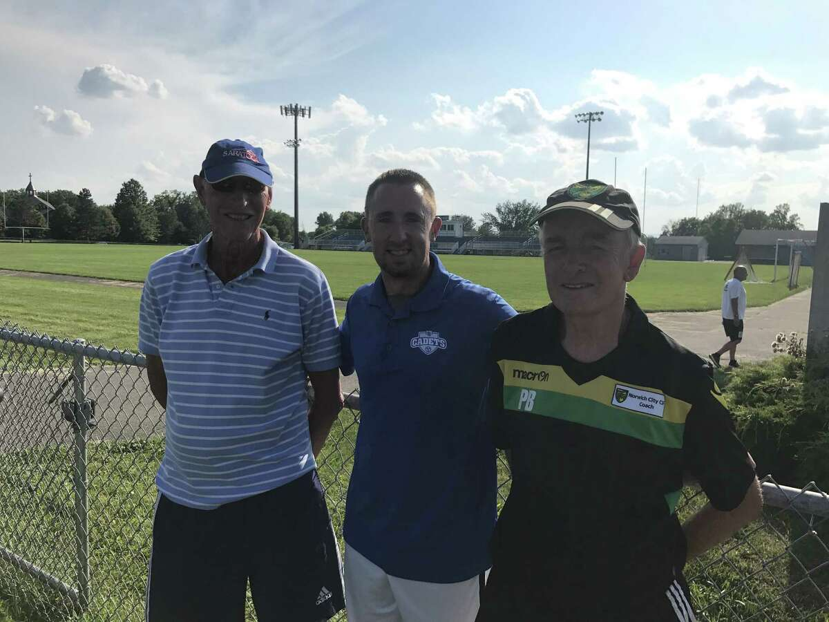 John Revell, left, and Pete Brown, right, of the Norwich City Football Club pose with LaSalle soccer coach Matt Michaud at the school's soccer camp on Tuesday, Aug. 1, 2017. (Jason Franchuk / Times Union)