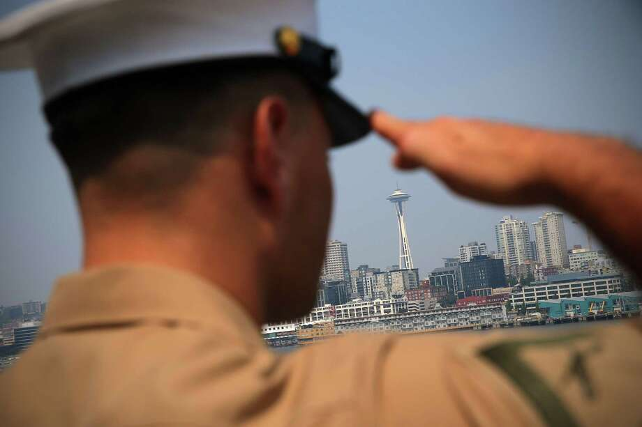 The Space Needle is visible as sailors and marines man the rails aboard the USS Anchorage during the Seafair Parade of Ships on Wednesday, August 2, 2017 on Puget Sound and along the Seattle waterfront. Photo: GENNA MARTIN, SEATTLEPI.COM / SEATTLEPI.COM