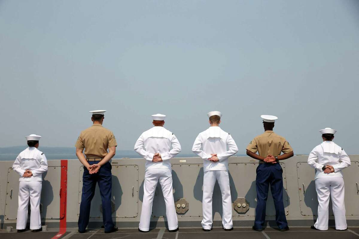 Sailors and marines man the rails aboard the USS Anchorage during the Seafair Parade of Ships on Wednesday, August 2, 2017 on Puget Sound and along the Seattle waterfront.