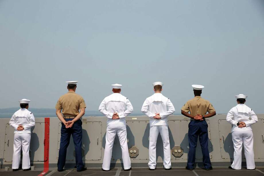 Sailors and marines man the rails aboard the USS Anchorage during the Seafair Parade of Ships on Wednesday, August 2, 2017 on Puget Sound and along the Seattle waterfront. Photo: GENNA MARTIN, SEATTLEPI.COM / SEATTLEPI.COM