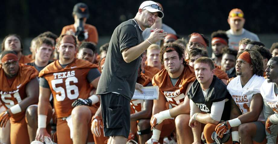 Coach Tom Herman gets the attention of players early with an intensity filled talk after warm up as the Longhorns begin their fall football practice at Frank Denius Fields at the University of Texas on July 31, 2017. Photo: Tom Reel/San Antonio Express-News