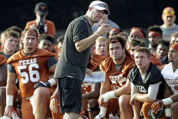Coach Tom Herman gets the attention of players early with an intensity filled talk after warm up as the Longhorns begin their fall football practice at Frank Denius Fields at the University of Texas on July 31, 2017.