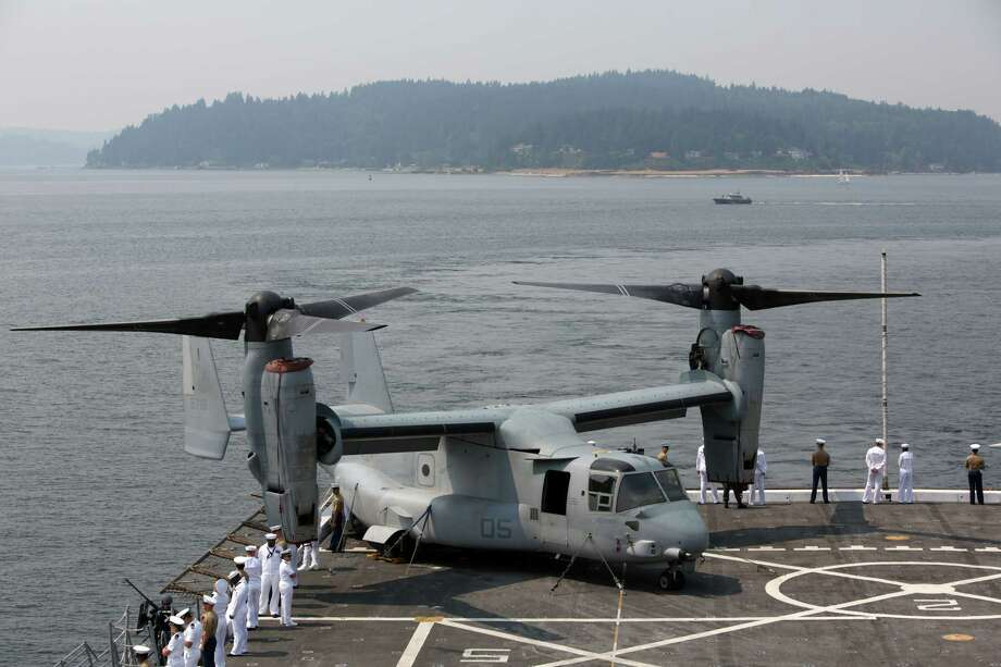 """A MV-22 Osprey is parked on the flight deck aboard the USS Anchorage during the Seafair Parade of Ships on Wednesday, August 2, 2017 on Puget Sound and along the Seattle waterfront.A search and rescue operation was underway Saturday for service members involved in the """"mishap"""" of an aircraft off the east coast of Australia, U.S. Marine officials said. Photo: GENNA MARTIN, SEATTLEPI.COM / SEATTLEPI.COM"""