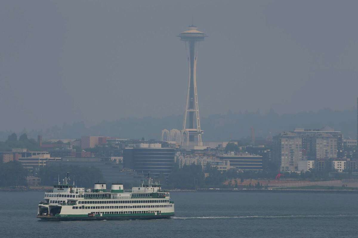 A thick layer of haze due to wildfires in British Columbia covers downtown Seattle, Wednesday, August 2, 2017.