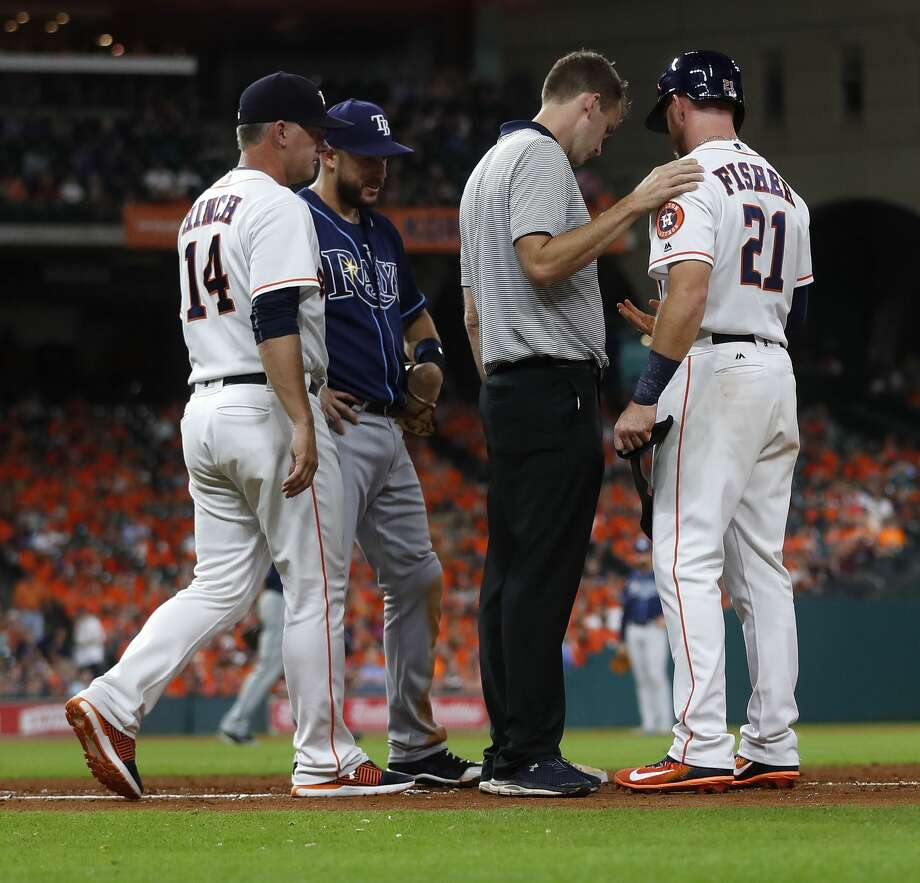 Houston Astros trainer Jeremiah Randall checks on Derek Fisher (21) at first base during the sixth inning of an MLB game at Minute Maid Park, Wednesday, Aug. 2, 2017, in Houston. ( Karen Warren / Houston Chronicle ) Photo: Karen Warren/Houston Chronicle
