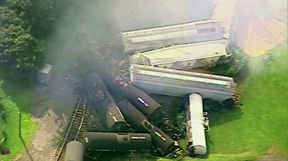 In this aerial image made from a video provided by WPXI, smoke rises in the air after dozens of cars of a freight train carrying hazardous materials derailed in Hyndman, Pa., Wednesday, Aug. 2, 2017. County officials ordered all residents of the small Pennsylvania town to evacuate after the derailment. (WPXI via AP) ORG XMIT: NYJK403 / WPXI
