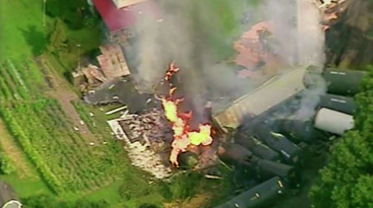 In this aerial image made from a video provided by WPXI, a fire burns after dozens of cars of a freight train carrying hazardous materials derailed in Hyndman, Pa., Wednesday, Aug. 2, 2017. County officials ordered all residents of the small Pennsylvania town to evacuate after the derailment. (WPXI via AP) ORG XMIT: NYJK402