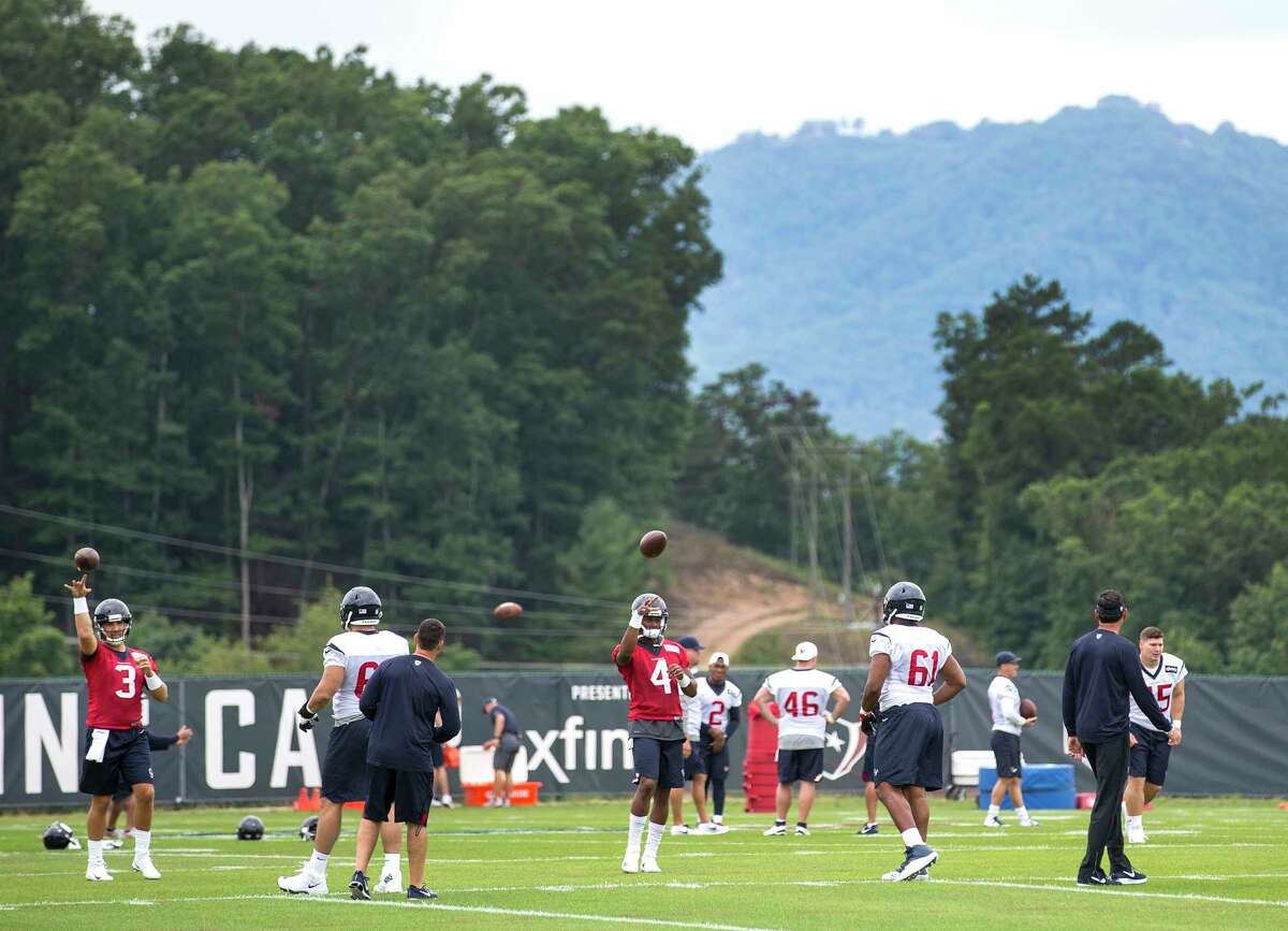 Houston Texans quarterbacks Tom Savage (3) and Deshaun Watson (4) throw passes in the shadow of the mountains during training camp at the Greenbrier on Wednesday, July 26, 2017, in White Sulphur Springs, W.Va. ( Brett Coomer / Houston Chronicle )