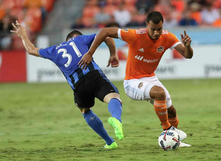 Houston Dynamo midfielder Juan David Cabezas (5) battles with Montreal Impact midfielder Blerim Dzemaili (31) during the first half of the game at BBVA Compass Stadium Wednesday, July 5, 2017, in Houston. ( Yi-Chin Lee / Houston Chronicle )