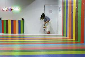 Founder Jordan Ferney steps into the the scratch-and-sniff room at Color Factory, a two-story, 12,000-square-foot interactive exhibition at 575 Sutter Stree in San Francisco.