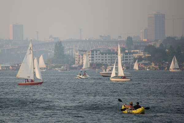 Lake Union is covered in haze from wildfires in British Columbia on Wednesday, Aug. 2, 2017.