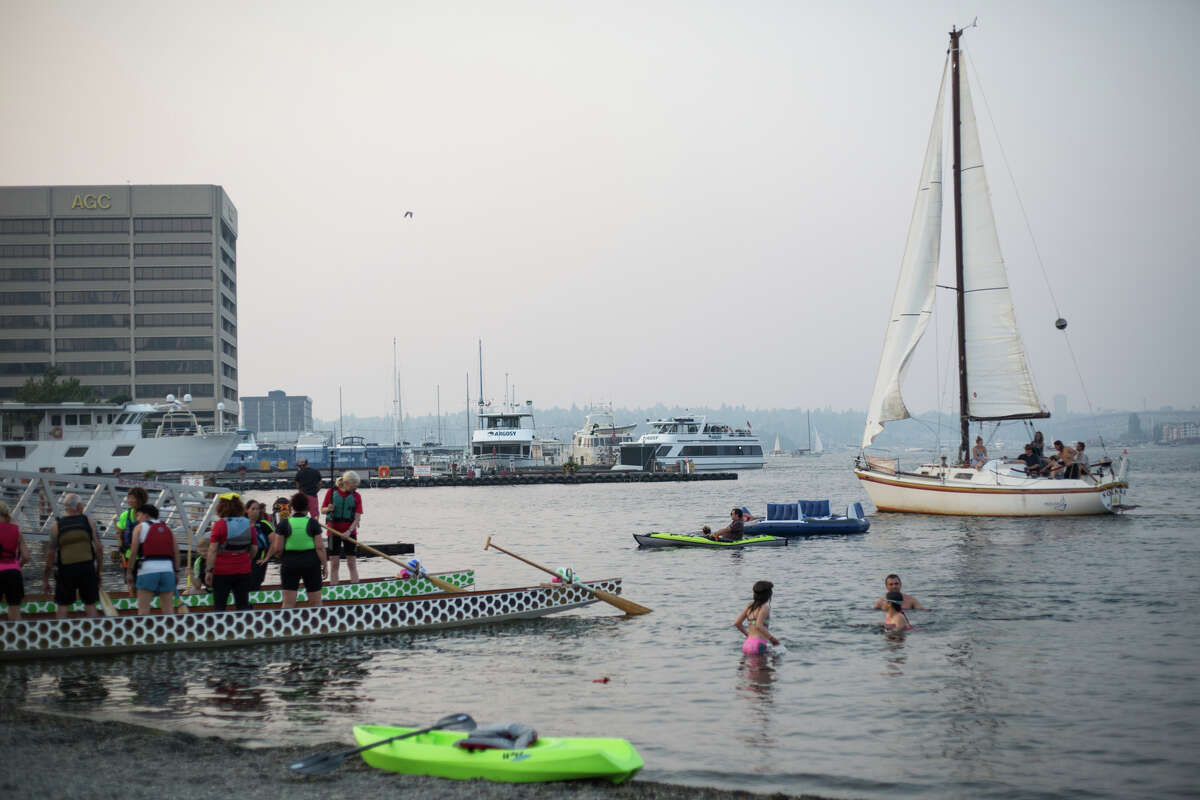 Swimmers, rafts and boats share space off Lake Union Park on Wednesday, Aug. 2, 2017.