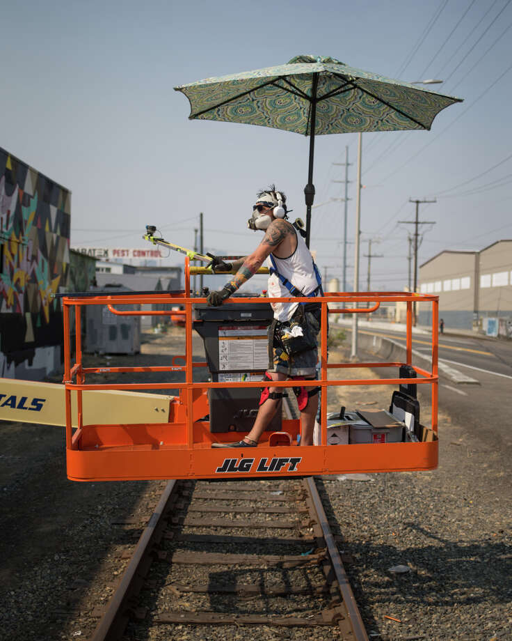 Blaine Fontana checks out his work from a distance on the SODO Track on Wednesday, Aug. 2, 2017. Photo: GRANT HINDSLEY, SEATTLEPI.COM / SEATTLEPI.COM