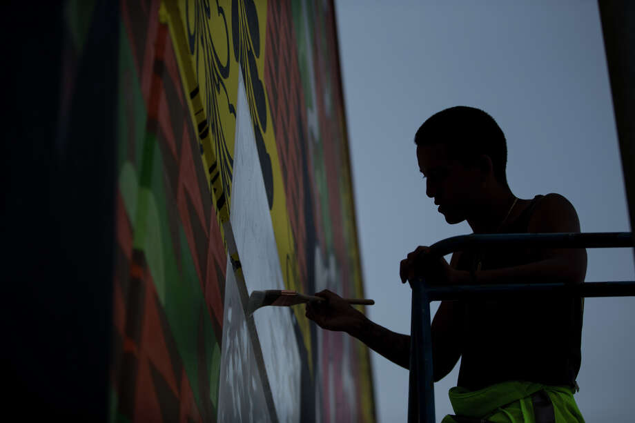 Kenji Stoll paints his piece on SODO Track, Wednesday, Aug. 2, 2017. Photo: GRANT HINDSLEY, SEATTLEPI.COM / SEATTLEPI.COM