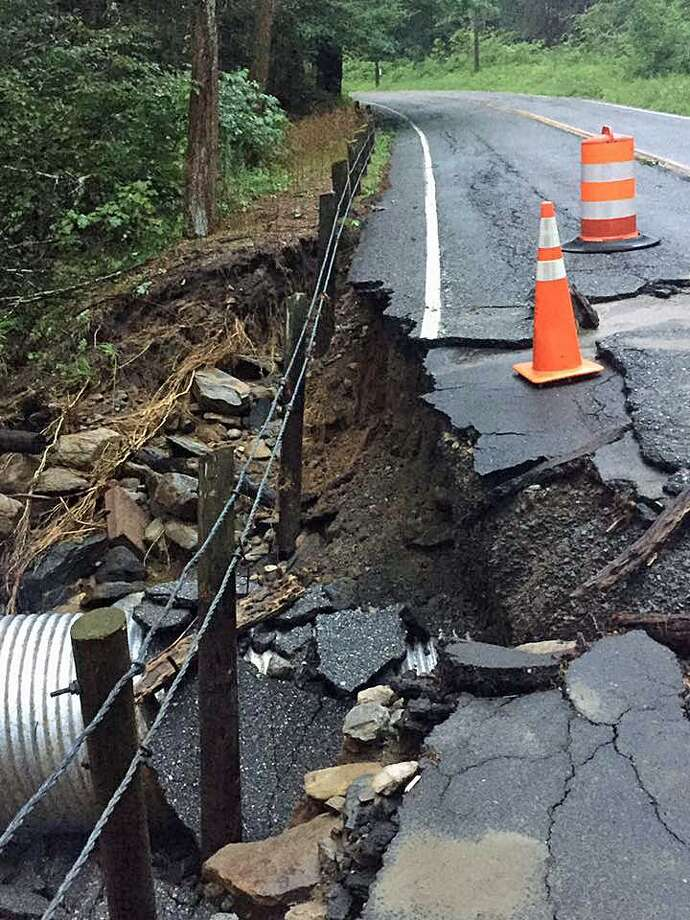 Up to 5 inches of rain fell in a strong thunderstorm on Wednesday, Aug. 2, 2017 in Cornwall, Conn. The rain washed out part of Route 125 near the historic Cornwall Bridge. Photo: State Rep. Brian Ohle /Contributed Photo